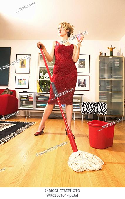 Woman drinking while mopping