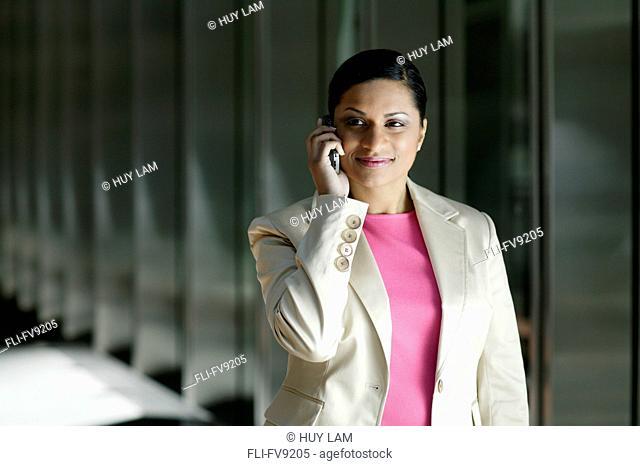 Businesswoman on Cell Phone, Toronto, Ontario