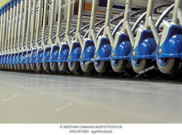 Wheels of parked baggage trolleys at Singapore's Changi Airport, Singapore