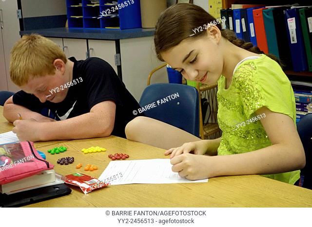 6th Graders Working on Math Problem, Wellsville, New York, United States
