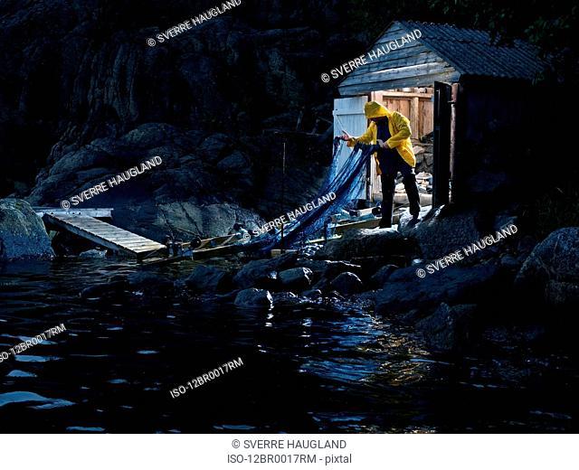 Fisherman pulling in net