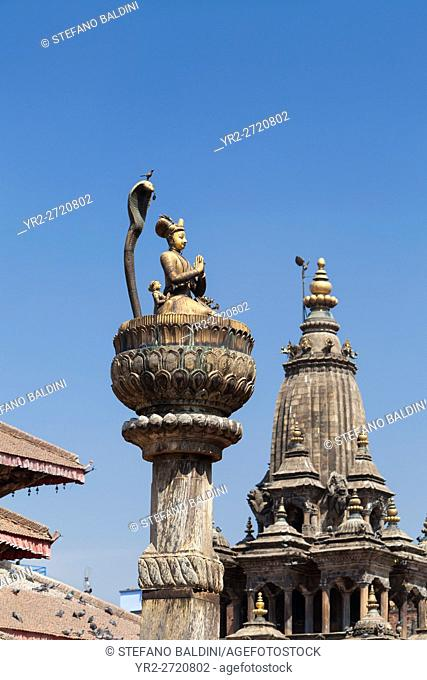 Statue of king Yoganarendra Malla with snake and bird, Durbar square, Patan, Nepal