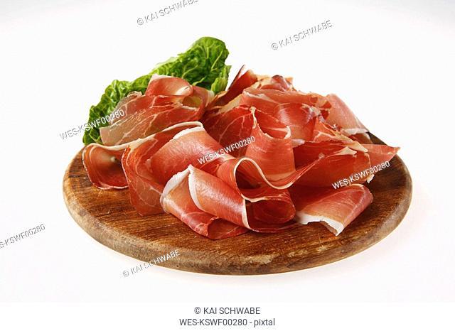 Sliced ham on wooden board