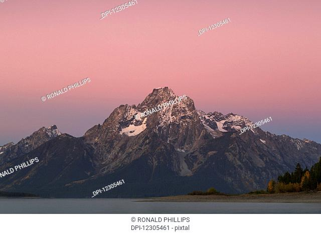 Mount Moran (elevation 12605 feet) at sunrise from Colter Bay, Grand Teton National Park; Wyoming, United States of America