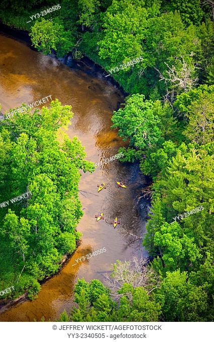 Kayaks on the Pere Marquette river in Michigan The PM is a designated Wild and Scenic River by law