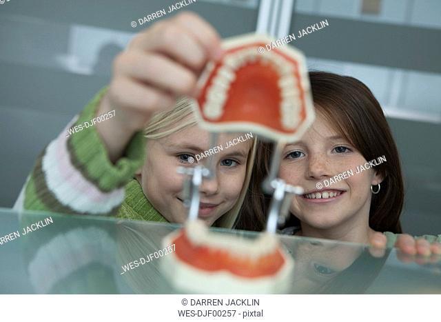 Germany, Bavaria, Landsberg, Two Girls 8-9 in dental surgery, portrait