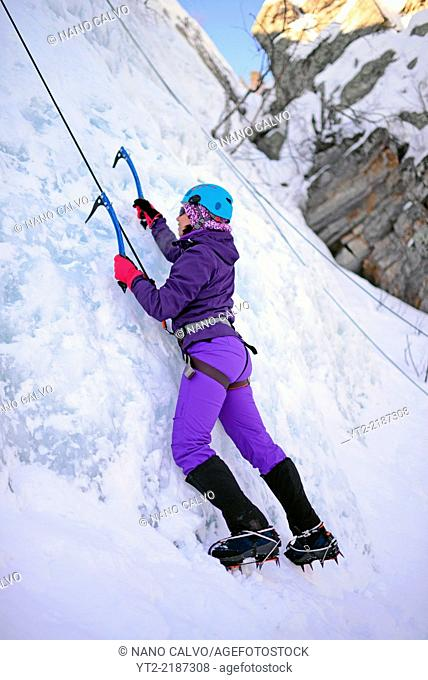 Young woman ice climbing in Pyhä, Lapland, Finland