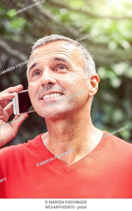 Portrait of mature man telephoning, close-up