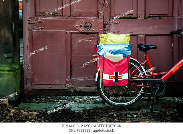 Detail of envelopes and red bike of royal mail, Liverpool, UK