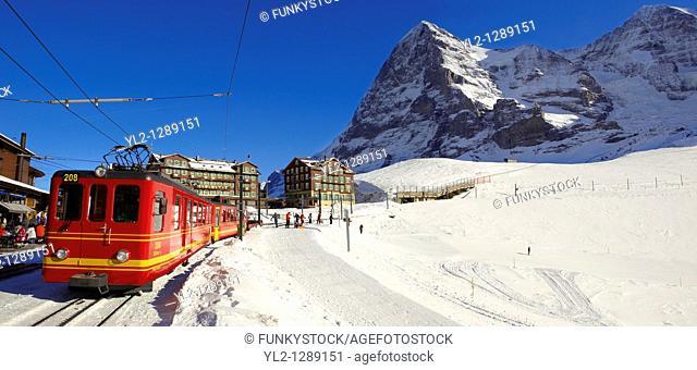 Jungfraujoch train at Kleiner Scheidegg in winter with The Eiger left then The Monch Mountains  Swiss Alps Switzerland