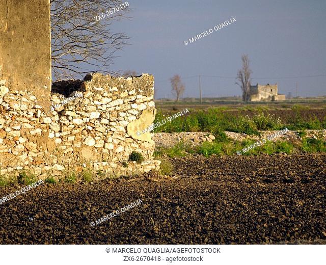 Stonewall detail of delta hut at ploughed rice fields. Ebro River Delta Natural Park, Tarragona province, Catalonia, Spain