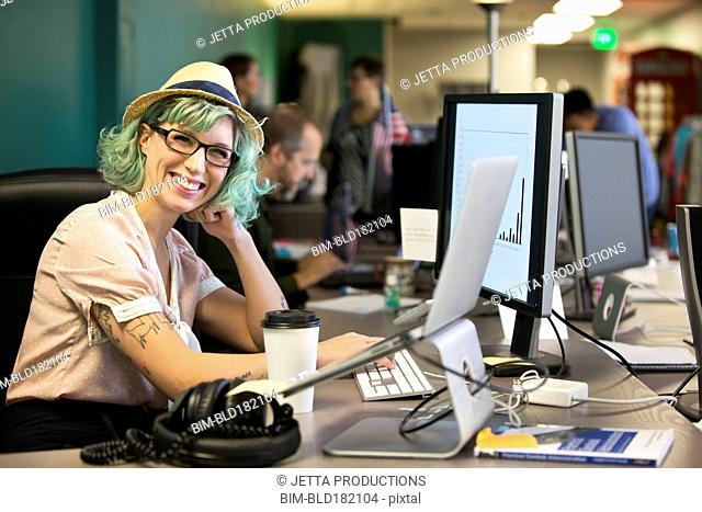 Businesswoman smiling at office desk