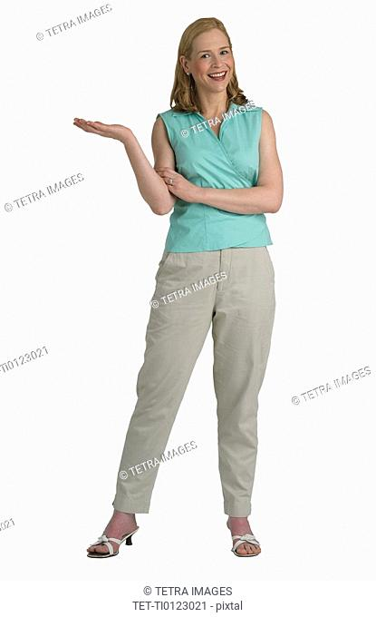 Studio shot of woman with hand held out to side