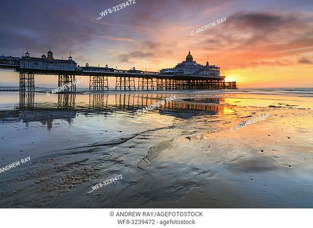 Sunrise captured from Eastbourne Beach at low tide in early March with the pier in the distance. A two second shutter speed was utilized to subtlely blur the...