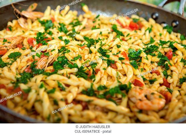 Pan of pasta with tomatoes and prawns