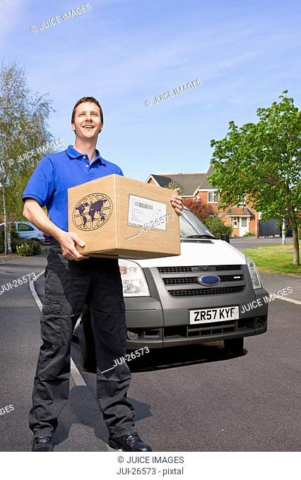 Delivery man delivering cardboard box