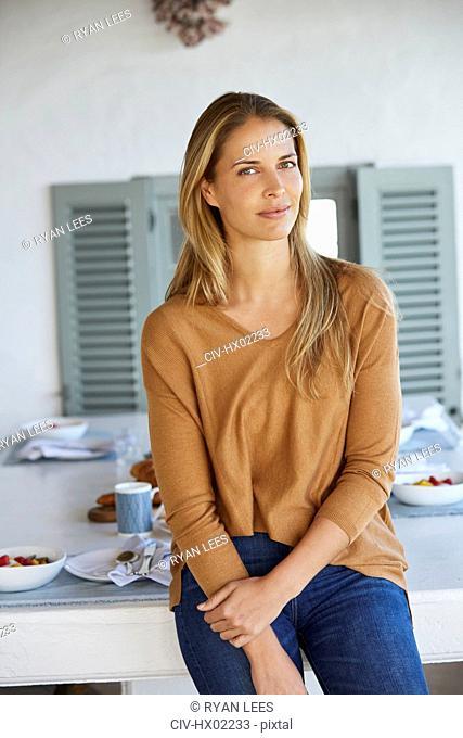 Portrait confident woman on patio