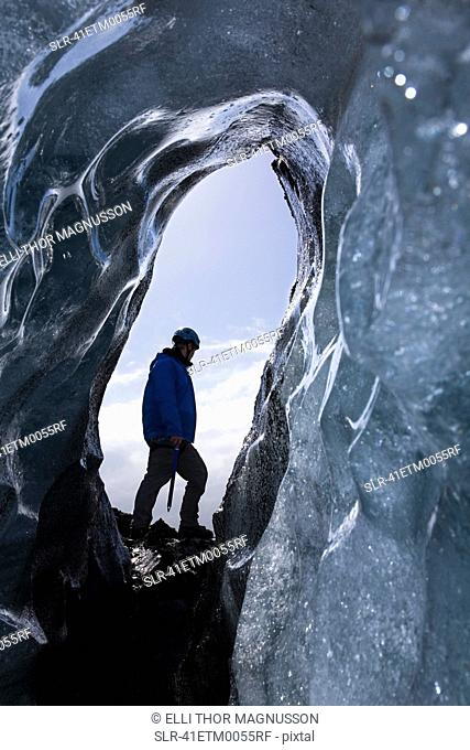 Hiker walking on ice formations