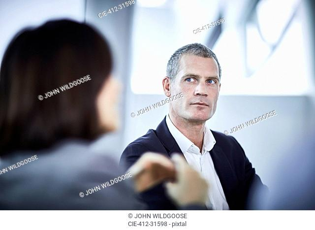 Serious businessman in meeting