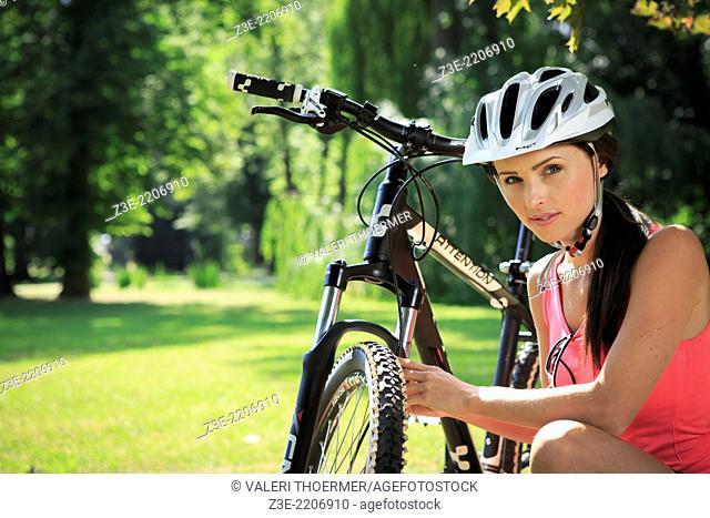 cycling woman taking a break in the park