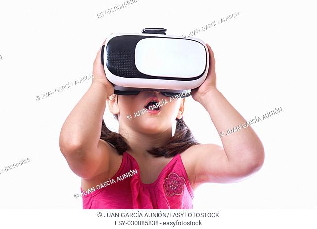 Little girl with virtual reality glasses. Isolated on white background. She is amazed