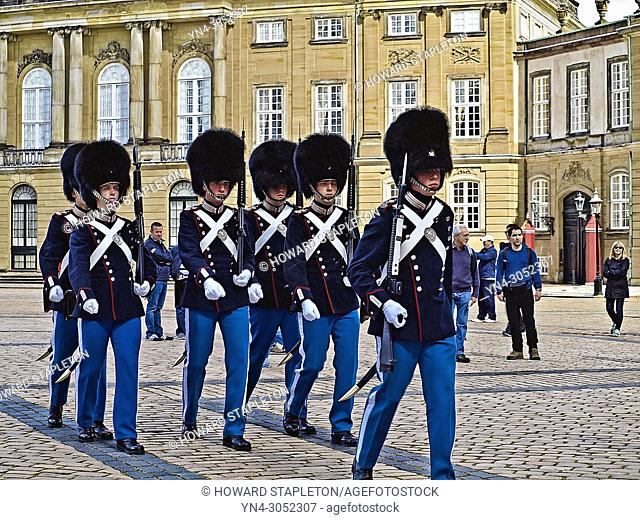 Tourists watch changing of the guard at Amalienborg Palace, The Danish Royal Palace. Copenhagen, Denmark,