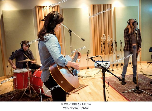 Music band performing in a studio