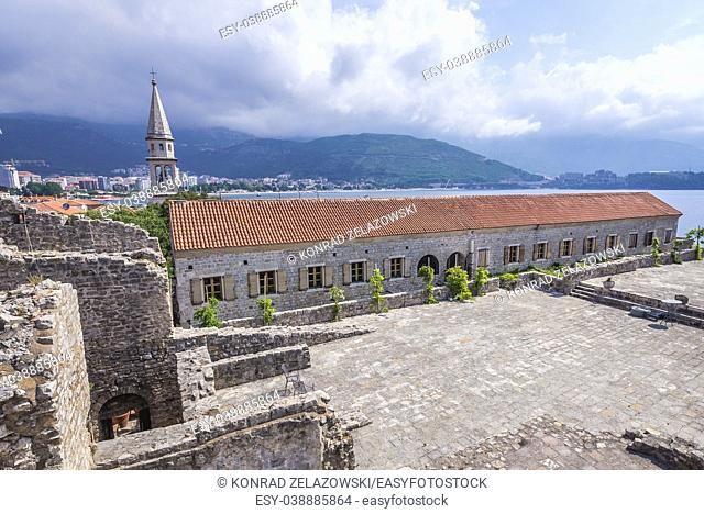On the roof of Citadel, Old Town of Budva city on Adriatic Sea coast in Montenegro. View with bell tower of Saint John the Baptist cathedral