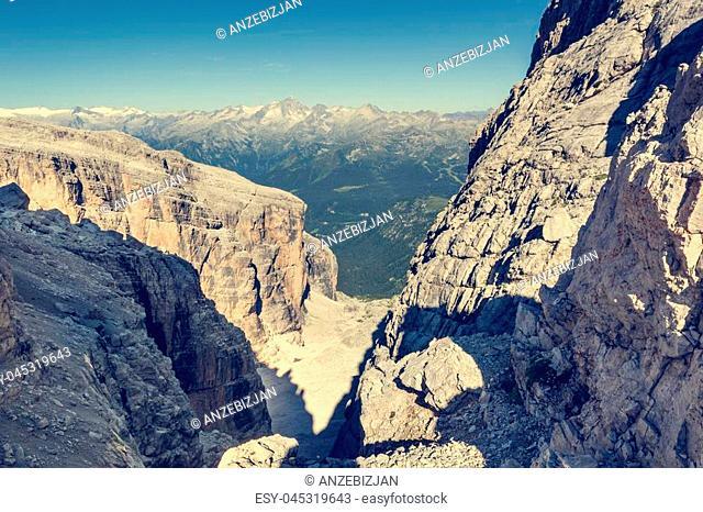 Mountain view through a narrow pass. Hiking Brenta Dolomites Sentiero delle Bocchette Alte