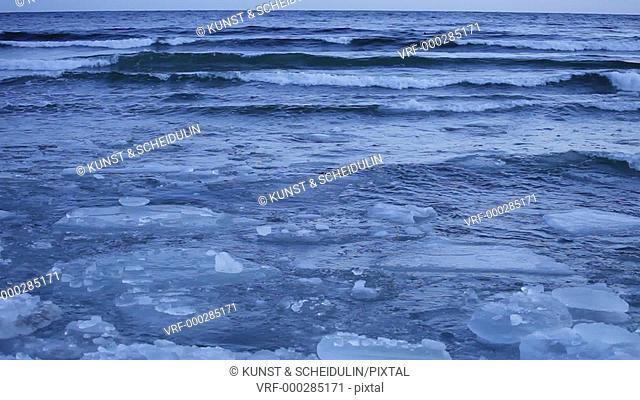 Ice floes are bobbing on the waves of the Baltic Sea on a very cold winter's day at the swedish High Coast / Höga Kusten