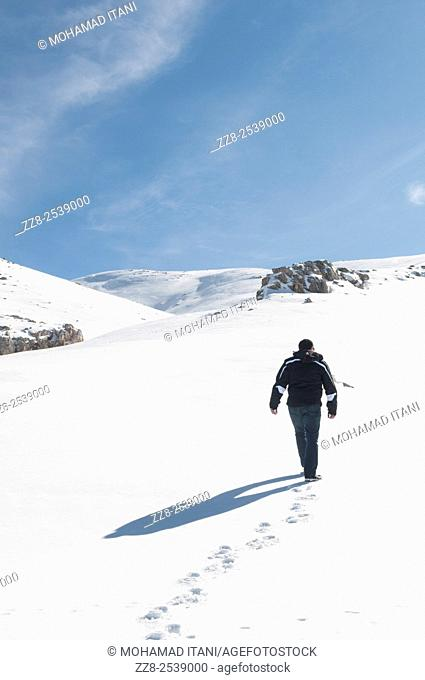 Man walking in the snow Faraya Lebanon
