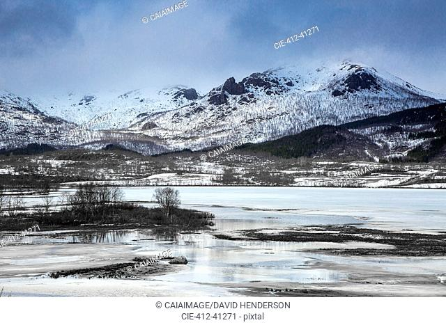 Tranquil snow covered mountains above fjord, Kavasen, Langoya, Vesteralen, Norway