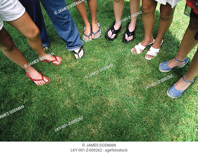 Downwards shot of girls' legs and feet