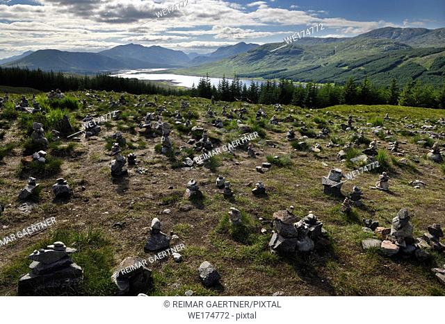 Stone cairns on Highway A87 at Loch Loyne with Spidean Mialach on left and Creag a' Mhaim Highland mountains on right Scotland UK