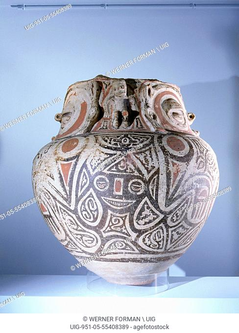 Funerary urn painted with a stylized representation of a crouching female fertility deity