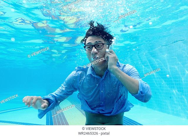 Business men call under the water