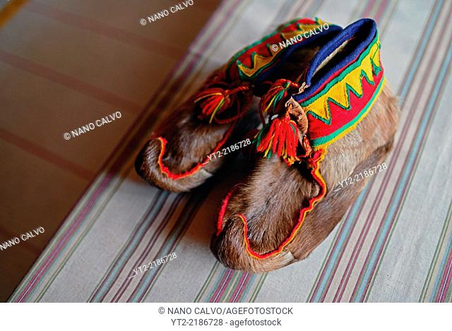 Traditional furry Sámi handmade shoes. Inside the home of Tuula Airamo, a Sámi descendant, and Reindeer farmer, by Muttus Lake