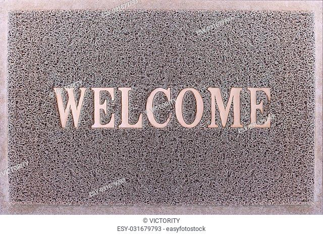 Welcome Door Mat Isolated. Friendly Grey Door Mat Closeup. Welcome Carpet. Foot Scraper Texture Background