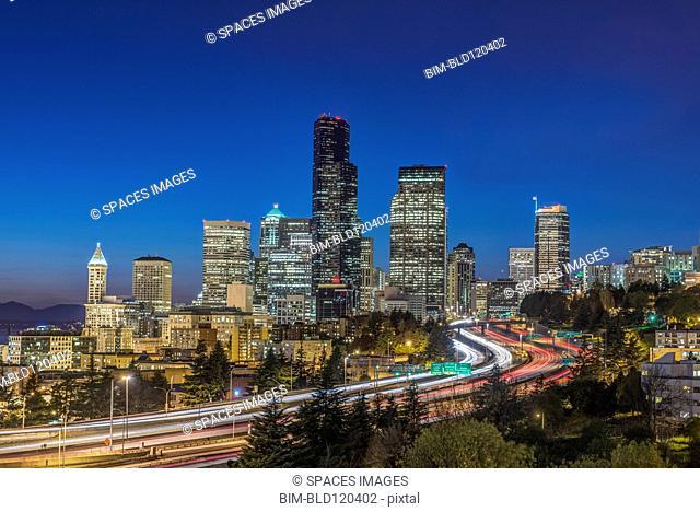 City skyline lit up at night, Seattle, Washington, United States