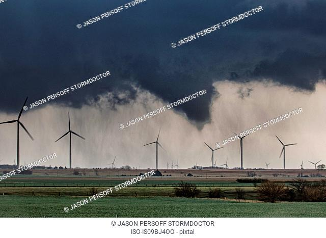 Tornado (with no visible contact over ground) behind wind farm over rural Kansas, US