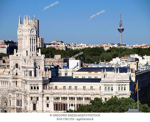 Communications Palace on Cibeles Square, Retiro Park and Torrespaña communications tower seen from the roof of the Circulo de Bellas Artes, Madrid, Spain