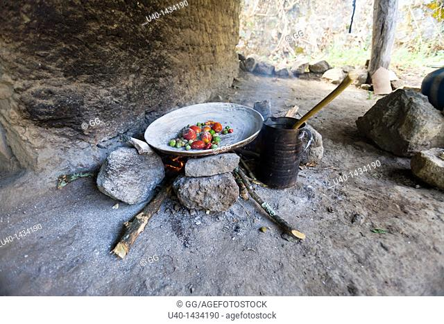 Guatemala, roasting vegetables on a comal
