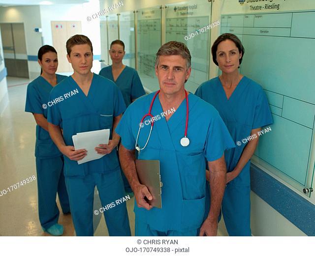 Team of surgeons in hospital corridor