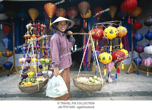 Street Scene / Street Vendor / Lantern shop in Background, Hoi An, Vietnam