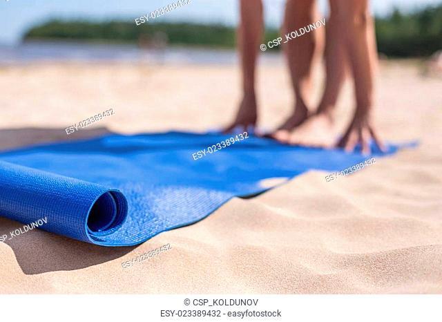 Girl doing yoga on a sunny day