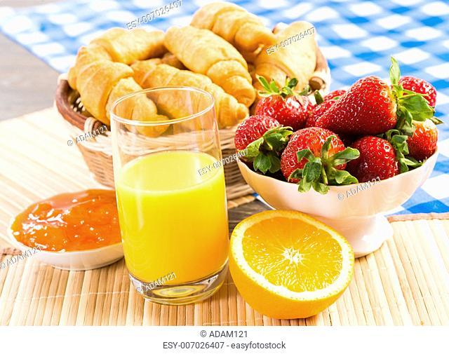 early breakfast, juice, croissants and jam, still life