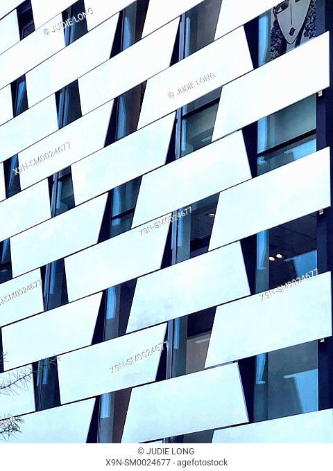 Los Angeles Patterns. Looking up at a Building with Angled Windows and White Panels forming a Pattern