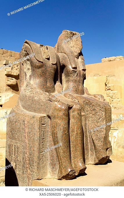 Statue of Ramses III (left), Hypostlye Hall, Medinet Habu (Mortuary Temple of Ramses III), West Bank, Luxor, Egypt