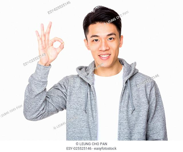 Young man with ok sign gesture