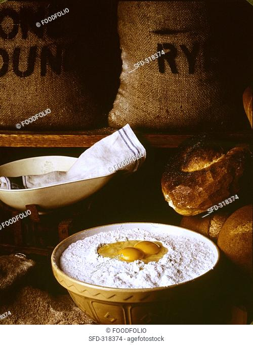 Baking still life with flour and eggs in a baking bowl